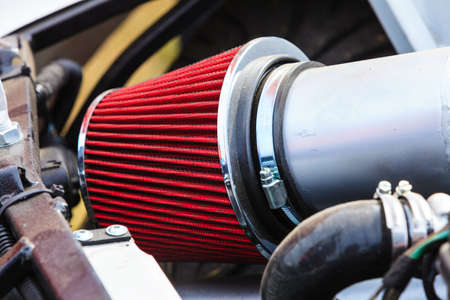 Agriculture equipment concept. Detailed closeup of air filter in big vehicle machinery Stock Photo