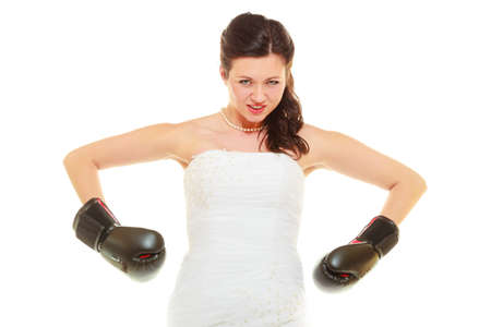dominant: Violence in relationship concept. Dominant bride wearing wedding dress and boxing gloves