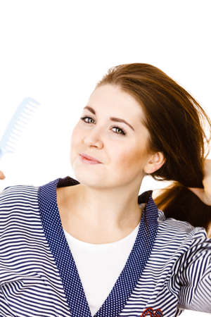 Woman combing her healthy hair using comb. Young latin female with beautiful  natural brown straight 54bc73678