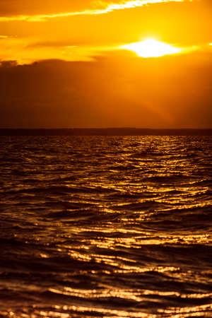 Beautiful seascape evening Baltic sea sunset horizon and cloudy sky. Tranquil landscape scene.