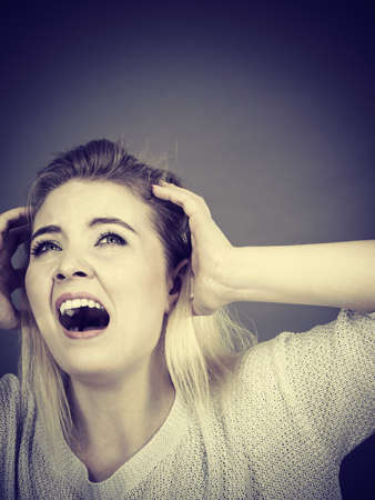 Unhappy woman screaming and yelling in pain. Bad, negative human face expressions, gestures concept. Фото со стока
