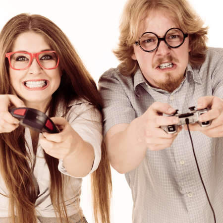 Happy couple enjoying leisure time by playing video games together. Studio shot isolated Banco de Imagens - 85090235