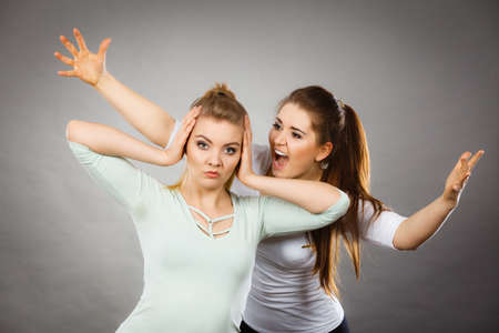 Two women having argue fight being mad at each other. Female telling off, ignorance concept.
