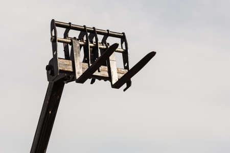 Machines, architecture building, heavy equipment concept. Bucket lift with blue sky in background