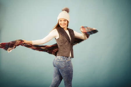 winter fashion: Clothing people and fashion concept. Cute young woman wearing cap. Shot taken in studio with attractive girl wearing nice clothes.