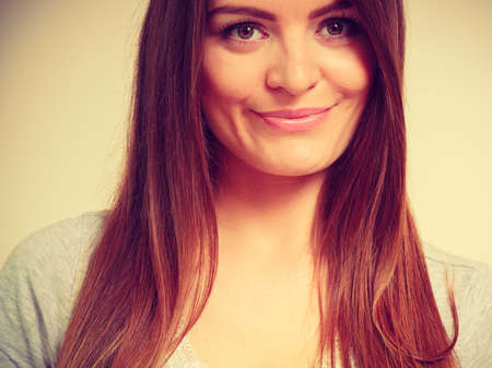 Portrait, feminity joy concept. Happy smiling beautiful woman with brown hair, indoor shot