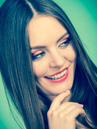 Positive emotions, natural beauty, face expressions concept. Closeup portrait of attractive happy smiling woman in brown hair and full makeup