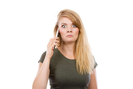 Unpleasant conversation, bad relationships concept. Angry young blonde woman talking on phone