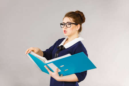Job problems concept. Sad bored business woman is tired having too much work. Stock Photo