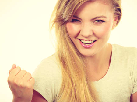 Success, achievement, winning concept. Happy positive blonde woman clenching fists out of joy. Stock Photo