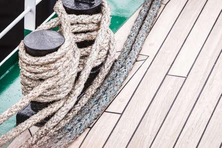 Jetty objects concept. Harbor marina bolt with ship and boats ropes, outdoor shot Stock Photo