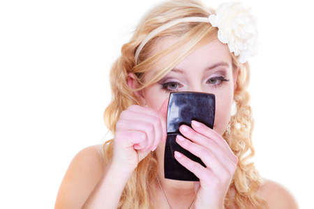 Feminity details concept. Blonde woman checking her makeup looking in small mirror Stock Photo