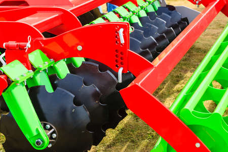 plowing: Agriculture equipment concept. Detailed closeup of disc harrow, agricultural machinery. Outdoor shot