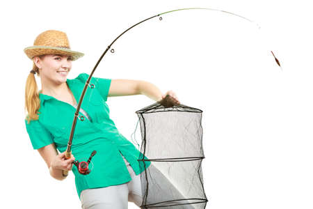 Fishery, spinning equipment, angling sport and activity concept. Happy smiling woman with fishing rod and net.