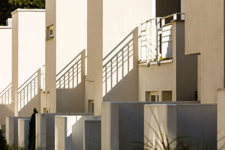 Modern semi detached houses in minimalistic shape, outdoor shot on sunny day.