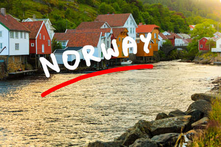 Wooden houses in harbor village Sogndalstrand Rogaland county, Norway Stock Photo