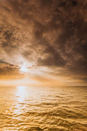 Colorful sunset over evening sea horizon, clouds sky. Tranquil scene. Natural background. Landscape. View from yacht
