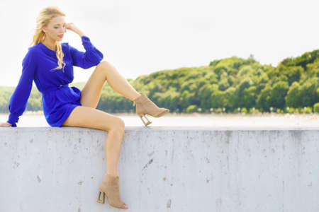 Fashionable woman wearing blue jumpsuit shorts perfect for summer. Fashion model outdoor photo shoot Foto de archivo