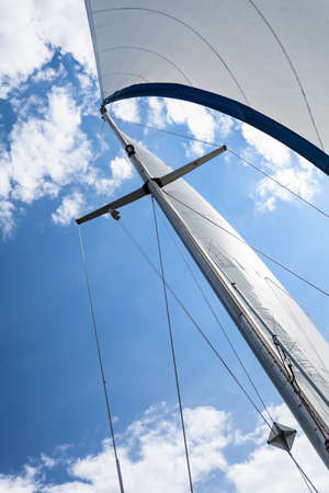 Detailed closeup of sail fabric on sailboat, outdoor shot. Marine objects concept.