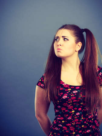 Young teenage woman being offended by something, feeling unhappy. Adolescence problems concept. Stock Photo
