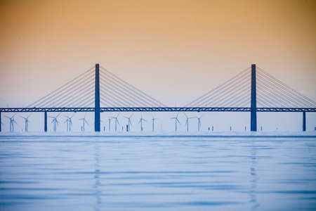Oresundsbron. The Oresund bridge link between Denmark and Sweden, Europe, Baltic Sea. View from sailboat. Overcast sky. Landmark and travel.
