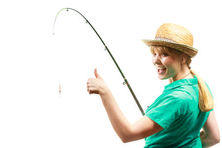 Fishery, spinning equipment, angling sport and activity concept. Woman with fishing rod showing thumb up gesture. Фото со стока