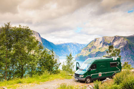 Tourism vacation and travel. Camper van and mountains landscape fjords in Norway