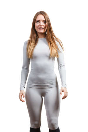 Fit fitness slim woman, sporty girl wearing hot gray sports thermolinen underwear, long sleeves top and leggings. Isolated on white
