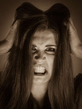 Angry pretty attractive woman being pissed off. Very frustrated lady having brown hair. Stockfoto