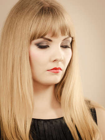 Dissatisfaction and unhappiness. Gorgeous beuty elegant young lady portrait. Angry dissatisfied attractive blonde stylish woman with strong make up. Foto de archivo