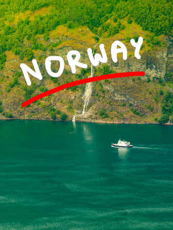 Tourism vacation and travel. Mountains landscape and large cruising ships on fjord in Norway Scandinavia.