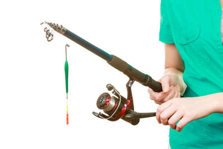 Spinning sport equipment concept. Person holding fishing rod with float and waggler with line.