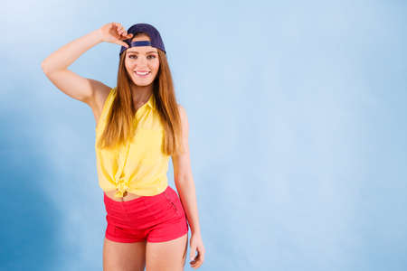 Fashion of teens. Beauty teenage girl presenting urban style. Fashionable young woman posing in stylish casual clothes.