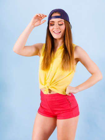 Healthy lifestyle. Happiness and joy. Young smiling fashionable girl in motion. Joyful sporty female teenager in jeans cap dancing.