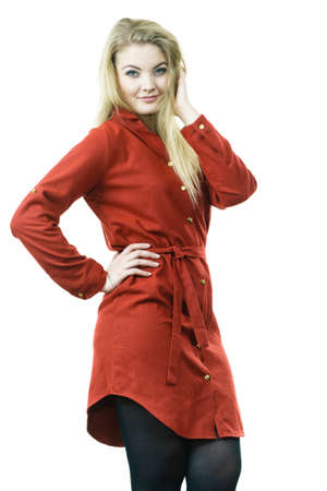 Fashionable woman wearing long red vintage dress and black leggings. Autumnal outfit concept.