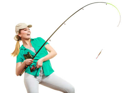 Fishery, spinning equipment, angling sport and activity concept. Happy smiling woman with fishing rod. 스톡 콘텐츠 - 98946348