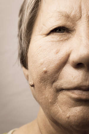 Details of senior woman half face. Elderly pensioner female, cheek close up.