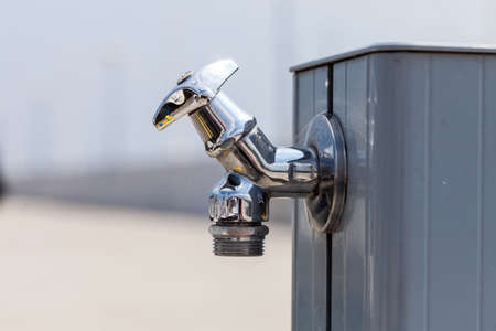 Elegant Small Metal Tap Water Outside For Use By Pedestrians. Stock