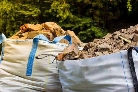 Wastes from the production or renovation. Two big bags container with rubble. Stok Fotoğraf