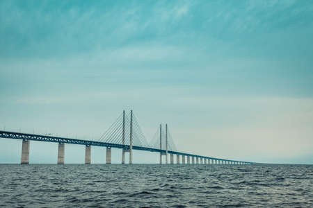 Oresundsbron. The Oresund bridge link between Denmark and Sweden, Europe, Baltic Sea. View from sailboat. Overcast sky. Landmark and travel.