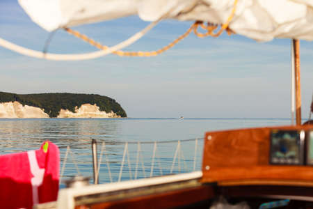 Sassnitz. The famous chalk cliffs shoreline of Jasmund National Park ruegen island germany, view from yacht boat