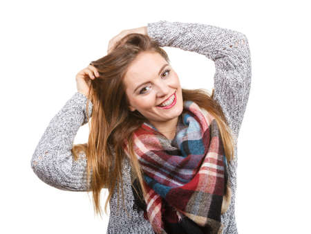 Portrait of long hair girl in gray sweater and warm woolen big scarf. Winter fashion.