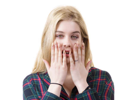 Amazed astonished young woman being suprised or shocked by something. Female having shock face expression. Stockfoto