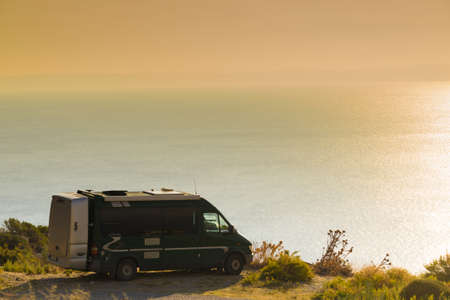 Tourism vacation and travel. Camper van on nature at morning time, Greece Peloponnese Mani Peninsula. Stock Photo