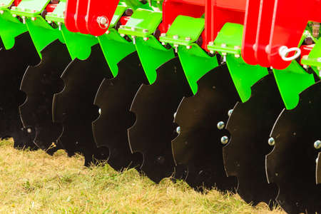 Agriculture equipment concept. Detailed closeup of disc harrow, agricultural machinery. Outdoor shot