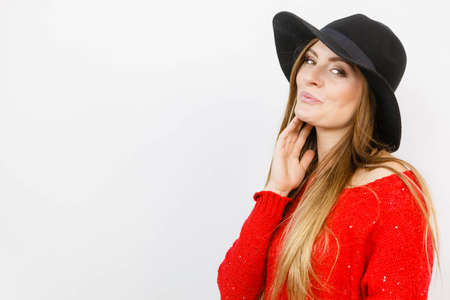 Fashion looks elegance clothing headwear concept. Gorgoeus lady smiling. Young blonde girl wearing elegant hat cheering expressing happiness Stock Photo