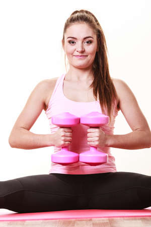 Woman exercising with dumbbells. Fit fitness sporty girl gaining building muscles. Bodybuilding.