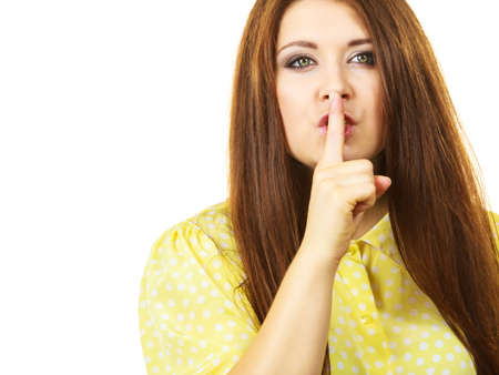Girl asking for silence or secrecy with finger on lips, hush hand gesture, on white, copy space text area Stok Fotoğraf
