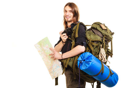 Man tourist backpacker on trip taking photo picture with camera. Young guy hiker backpacking holding map. Summer vacation travel. Isolated on white background.
