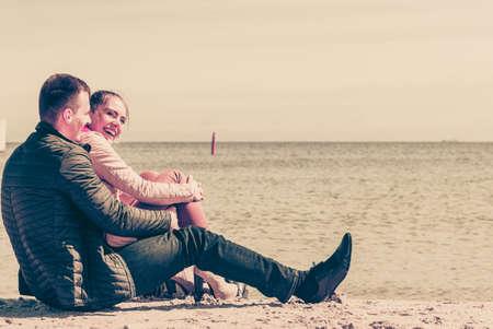 Romance, beautiful relantionship concept. Happy couple having date on beach near sea.